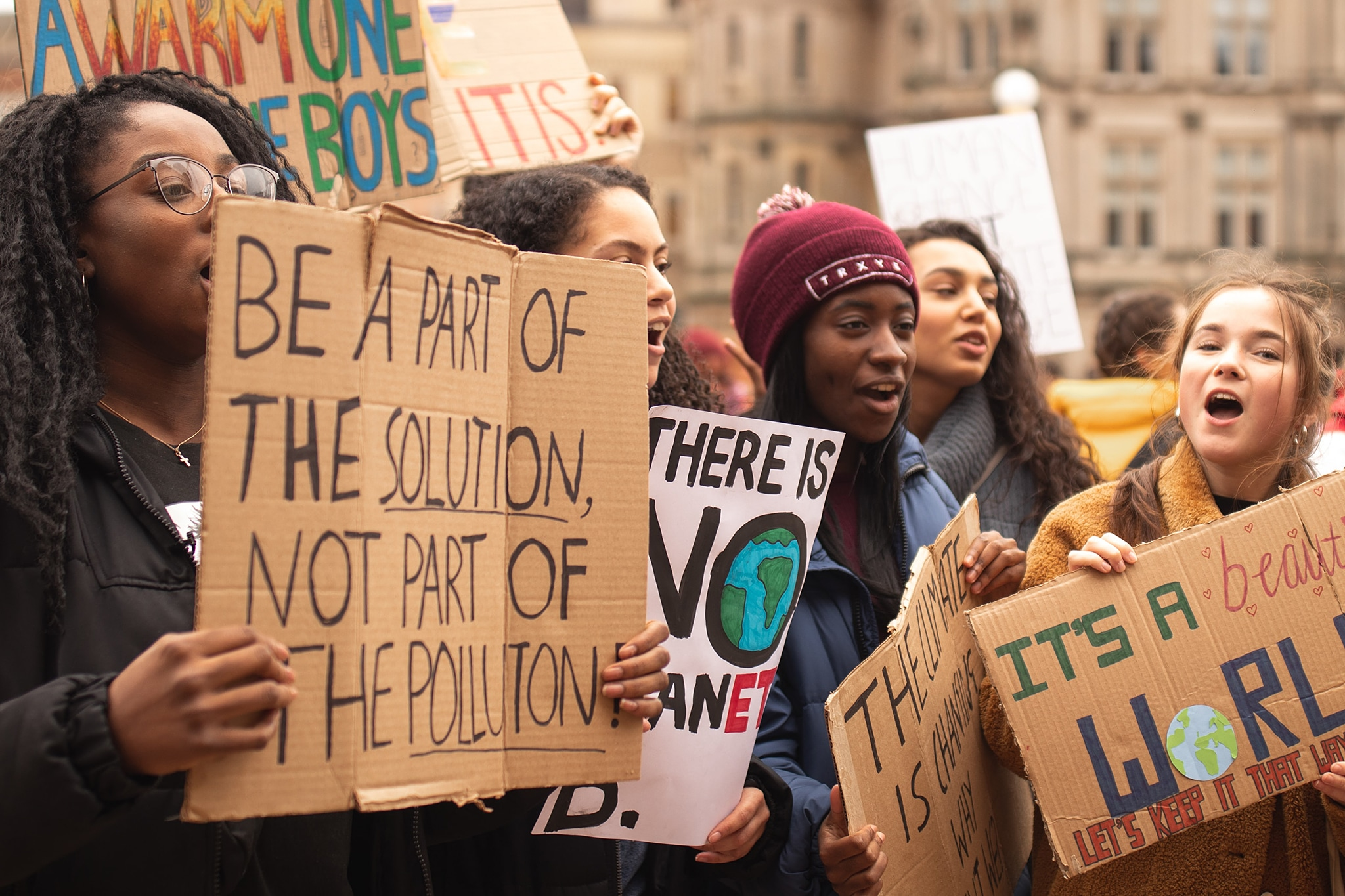 Young women demonstrating intersectional feminist leadership through social justice activism for the environment