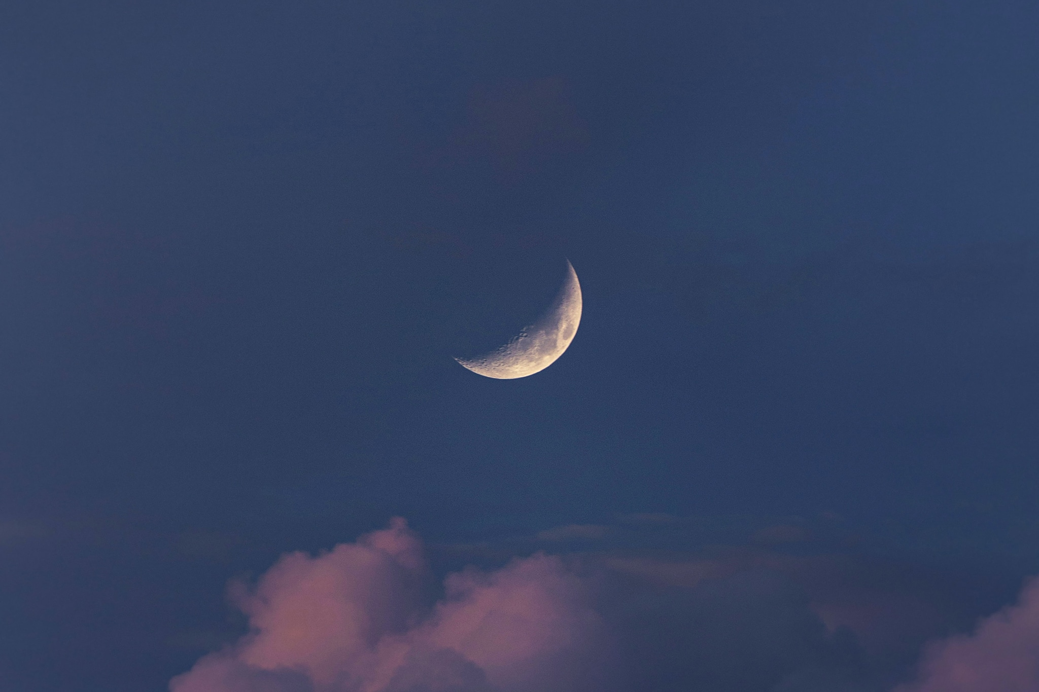 Crescent moon among clouds in dark sky, signalling the blog goals and intentions I set for this site in June 2020