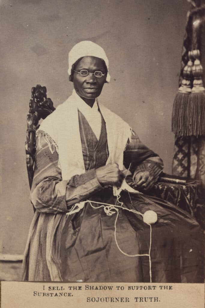 Sojourner Truth in high-backed chair holding knitting
