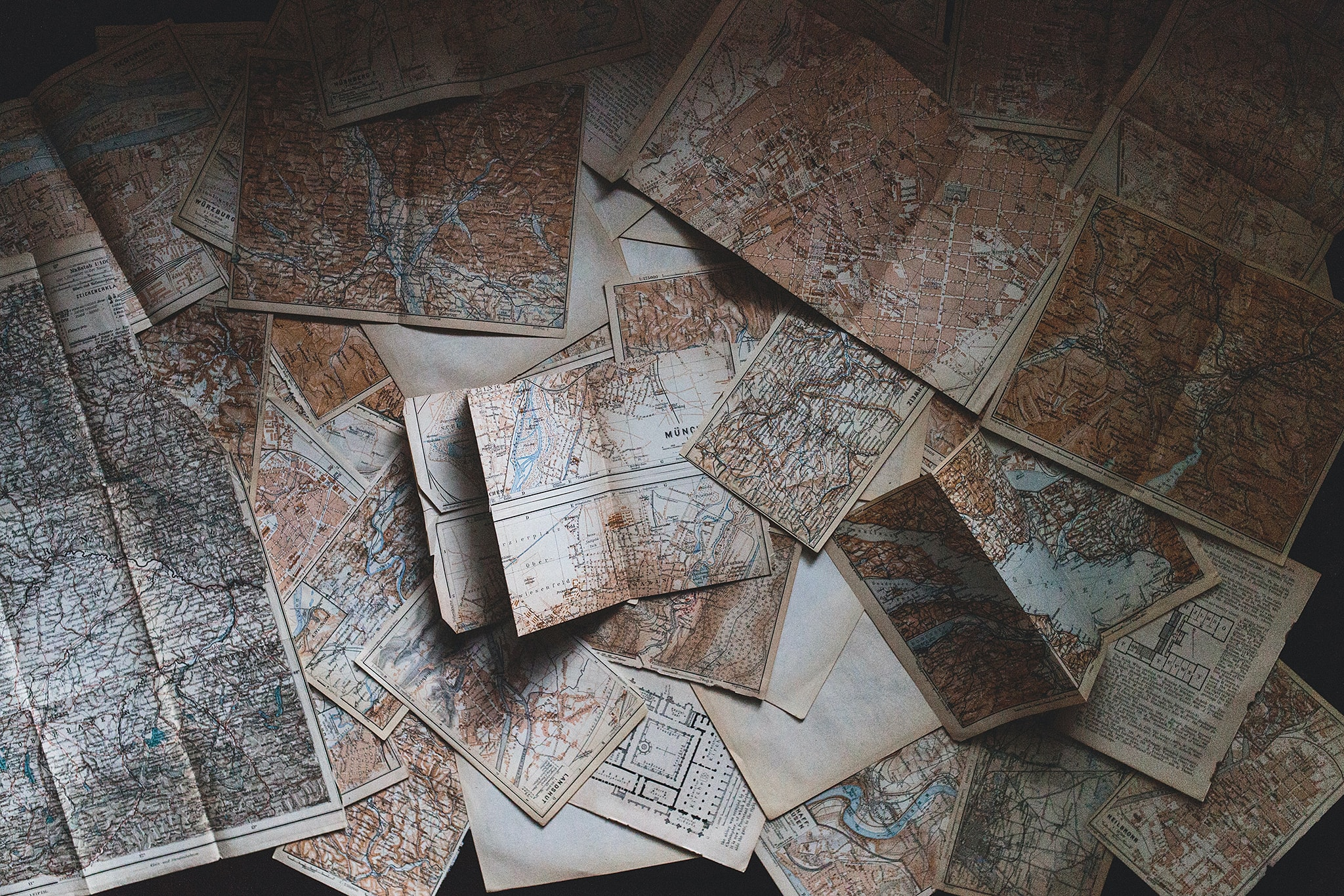 A jumbled stack of vintage maps