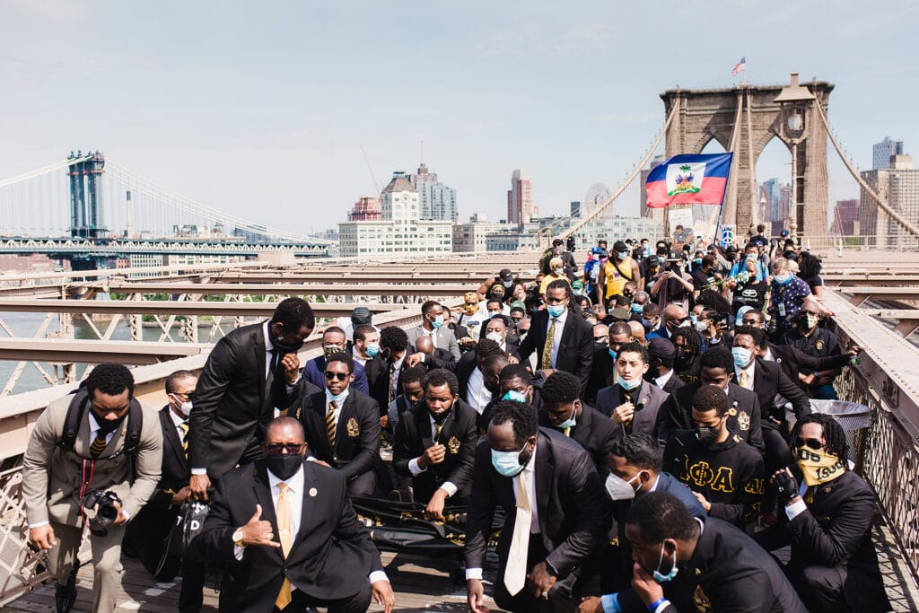 Protests kneel on a bridge for Black Lives Matter, representing the public reckoning of racial injustice that is not captured in corporate diversity and inclusion practices
