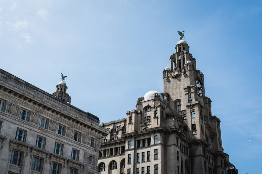 A grand building in Liverpool, United Kingdom against blue skies in June 2017 where I met the editor of Bristol University Press with whom I eventually published my first academic book