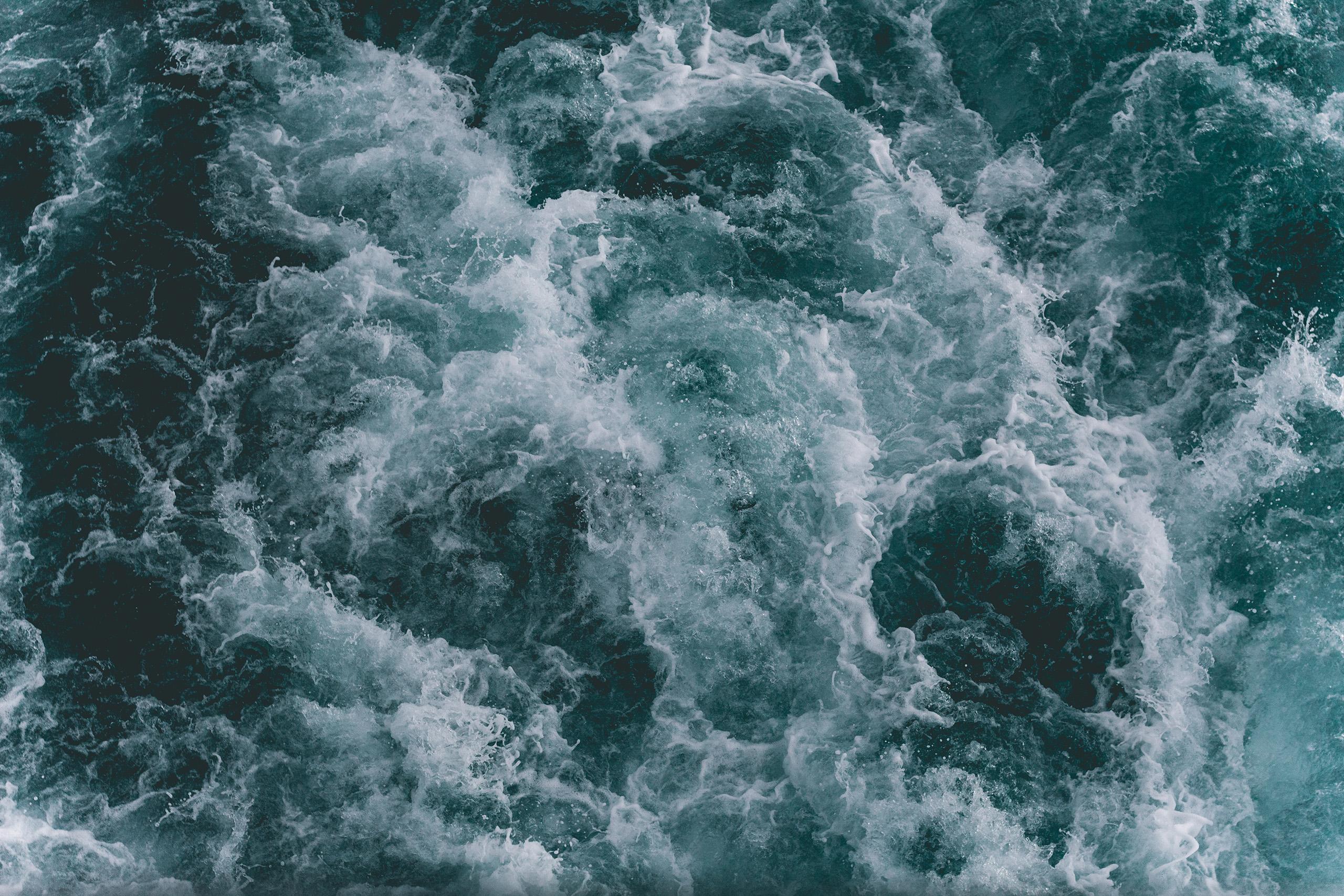 Dark green overhead view of waves